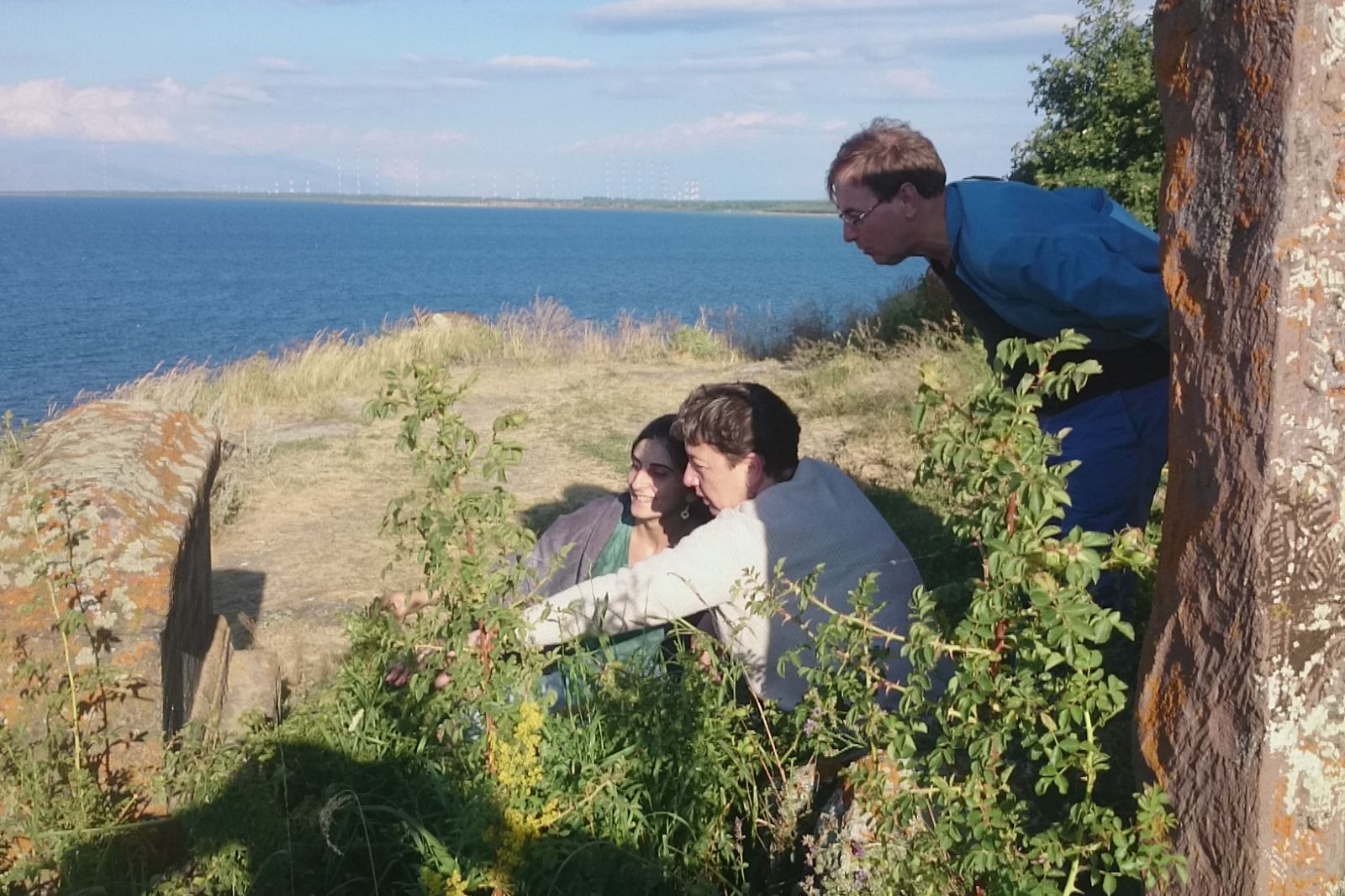 Instructor of Armenian language helps to read an epitaph on a medieval tomb near Hayravank Monastery on Sevan lake. From left to right: Instructor of Armenian language Sona Mnatsakanyan, Yana Tchekhanovets from Hebrew University of Jerusalem and Rene Bekius from Erasmus University in Rotterdam