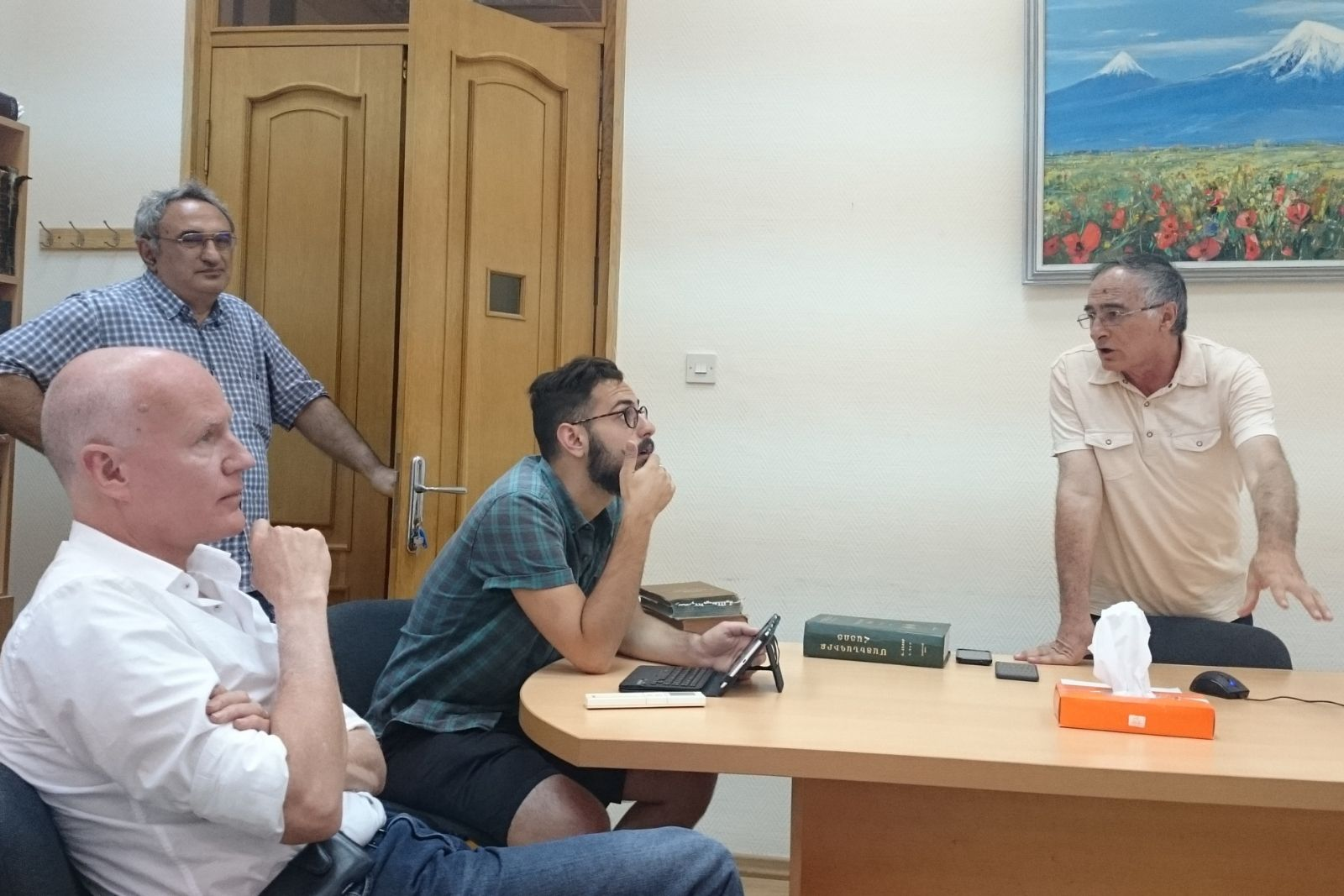 Merujan Karapetyan is lecturing about the history of Armenian printing to the participants of Armenian Studies summer school 2016 John Winter and Nicholas Matheou.