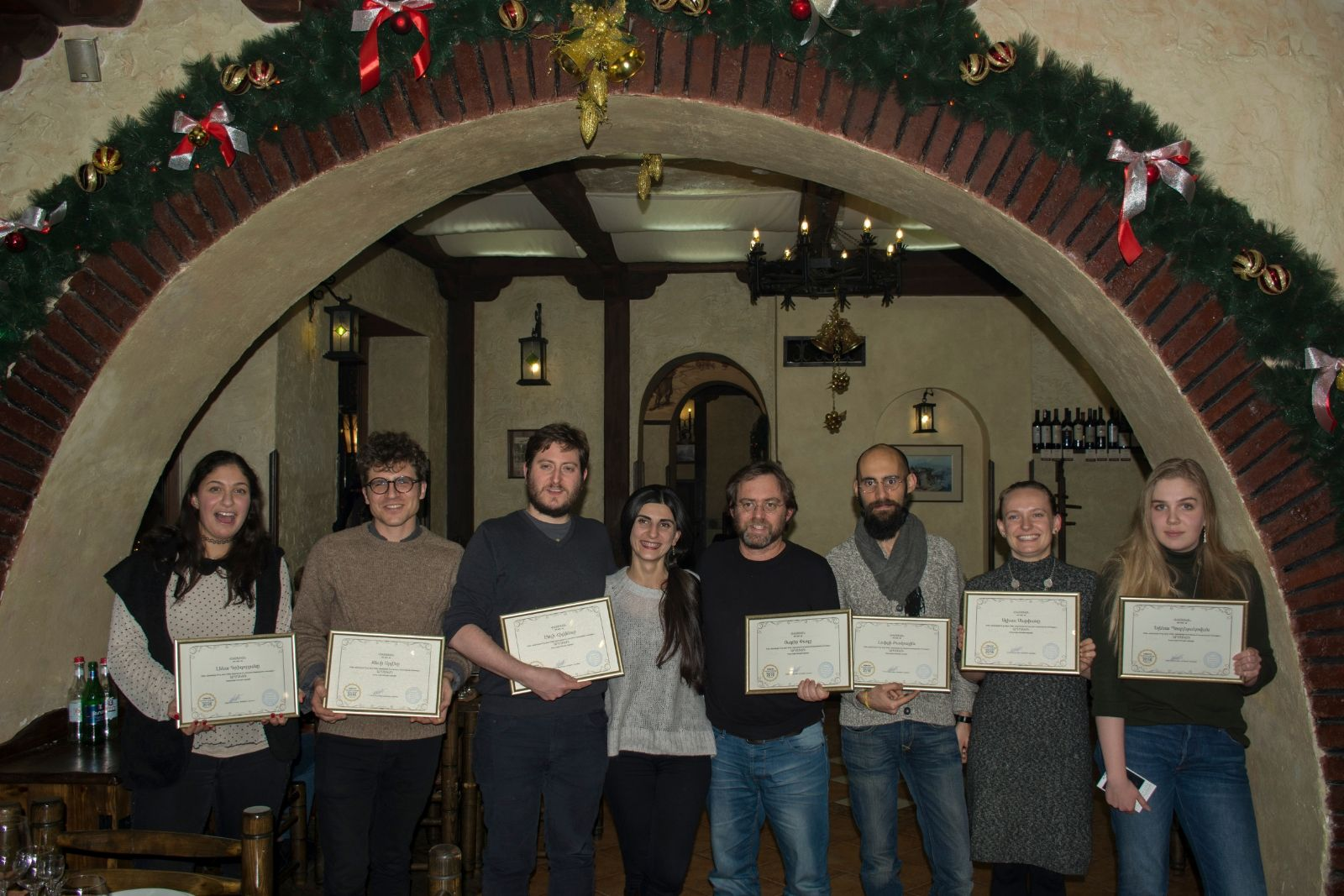 Participants of Armenian language winter school 2016 received their certificates after farewell dinner. From left to right: Lena Krikorian, Jesse Siragan Arlen, Andy Hilkens, Sona Mnatsakanyan (instructor of Armenian language), Yakir Paz, Luigi Bambaci, Alyssa Maria Mathias, Elena Pozdnyakova